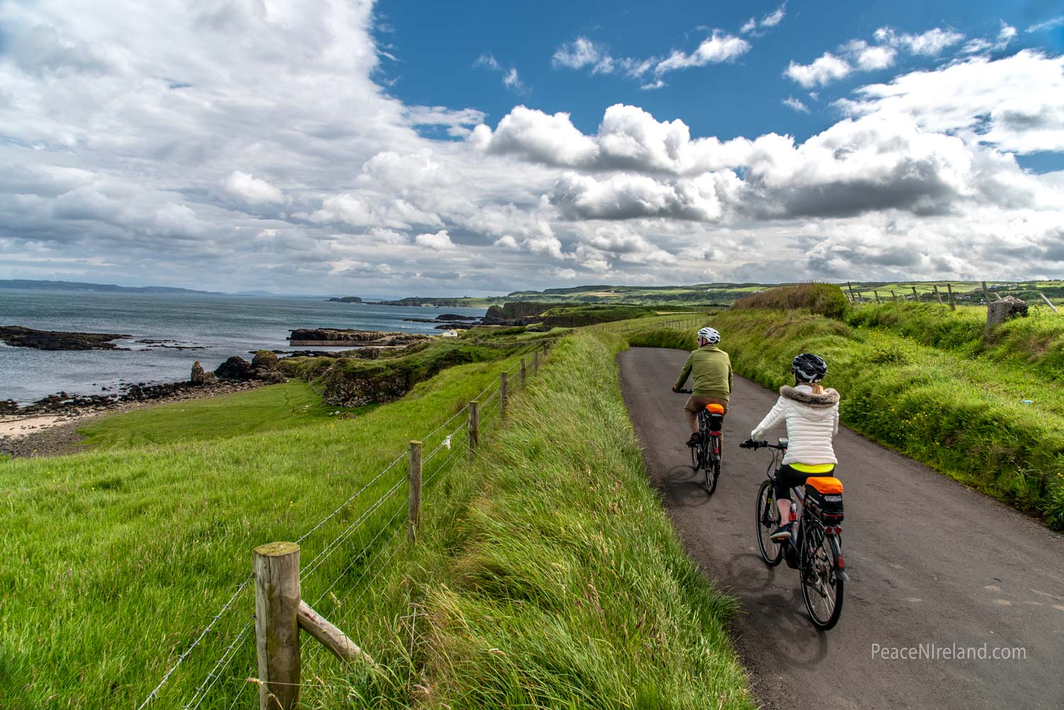 A couple enjoy the scenery on the North Coast, County Antrim, Northern Ireland